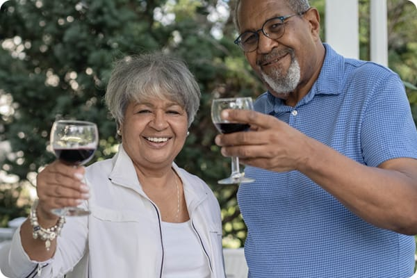 African-American seniors toasting with wine glasses
